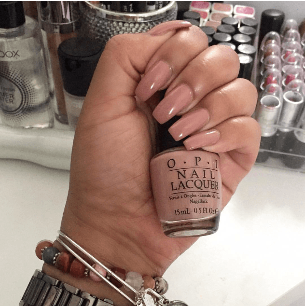 Nude blondes with painted nails